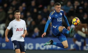 Jamie Vardy scores with a spectacular volley as Tottenham's Eric Dier watches on.