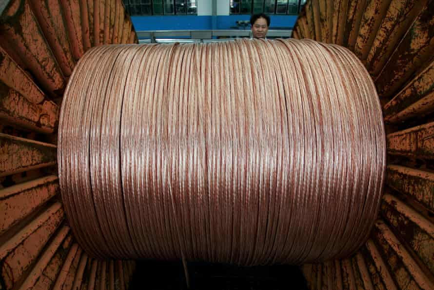 An employee works at an electricity cable factory in Baoying, Jiangsu province, China.
