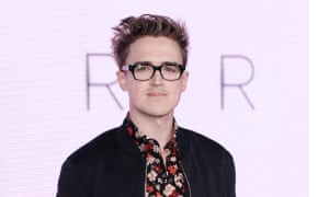 Tom Fletcher began his children's book career writing about a pooping dinosaur. His latest book is a dystopian YA novel.