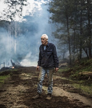 Steve Stands before the remnants of a burning work shed in Victorias Central Highlands