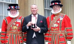 Sir Ian Botham after being knighted for his services to cricket and his charity work, at Buckingham Palace in October 2007.