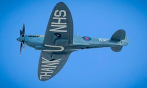 A 'Thank You NHS' Spitfire flying over the Royal Infirmary of Edinburgh today during a tour around Scottish hospitals to raise money for NHS Charities Together.