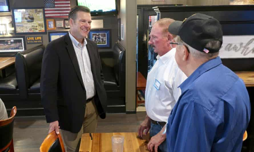 Kris Kobach, left, a Republican candidate for the US Senate in Kansas, speaks with supporters in Holton, Kansas.