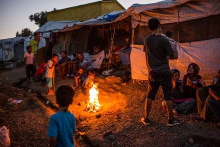 People – mainly from Afghanistan – at the Olive Grove camp, next to Moria