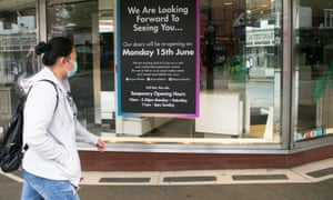 Signs are placed on the window of a department store in Wimbledon preparing to open its doors on Monday 15 June as part of the government easing of the coronavirus lockdown.