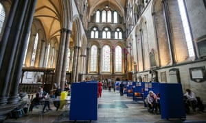 People receive coronavirus vaccines inside Salisbury cathedral, UK.