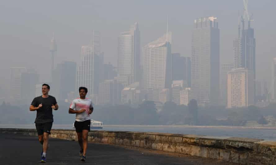 runners against a hazy Sydney skyline