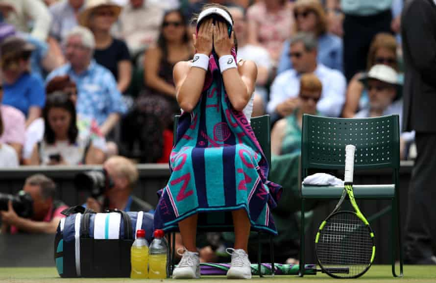 Johanna Konta covers her face with a towel