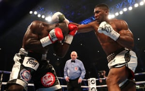 Anthony Joshua goes on the offensive as Carlos Takam covers up.