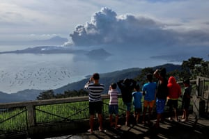 Residents watch from in Tagaytay city