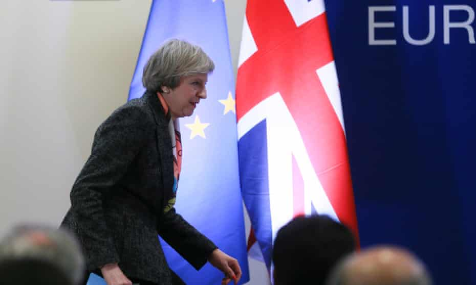 Theresa May leaves the podium after a press briefing during the European spring summit in Brussels.