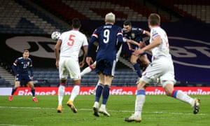 John McGinn (centre) scores his, and Scotland's, second goal of the game.