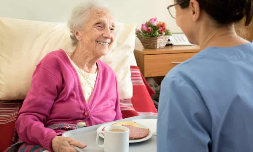 An older woman at home with her care provider