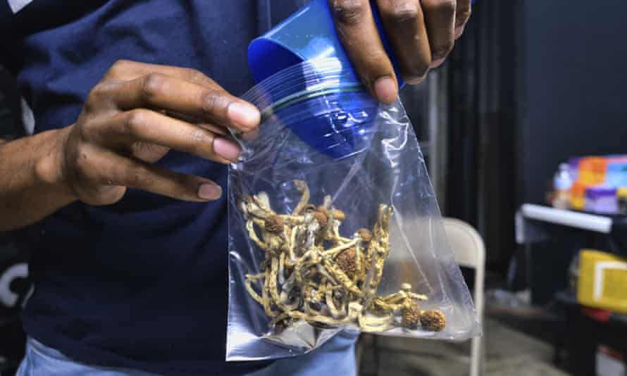 A vendor packages psilocybin mushrooms at a cannabis market in Los Angeles.
