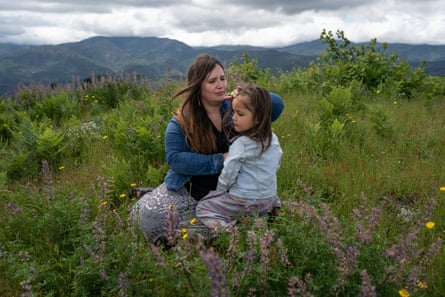 Denia sits with her daughter Evelyn at their favorite lookout-spot in Hoopa that looks out over the entire Hoopa Valley.