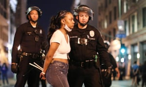 A woman is arrested after curfew went into effect during demonstrations over George Floyds death downtown in Los Angeles