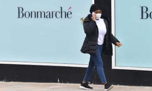 A woman walks past the shop front of clothes retailer Bonmarche in Stoke-on-Trent, Staffordshire.