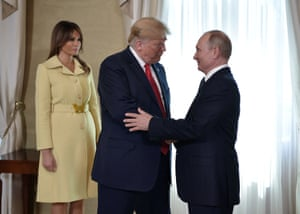 Putin and Trump, as First lady Melania Trump stands nearby, during the meeting