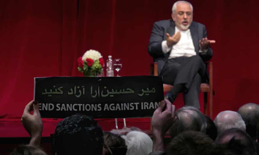 """A sign during an interview with Iran's foreign minister in New York carries one message in Persian and another in English. """"Release [opposition leader] Mir Hossein Mousavi,"""" it reads in Persian."""