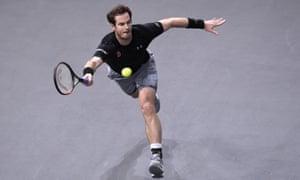 Andy Murray struggles to cope with the Novak Djokovic serve.