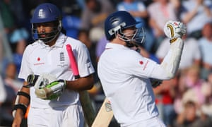 James Anderson celebrates securing the draw with Monty Panesar.
