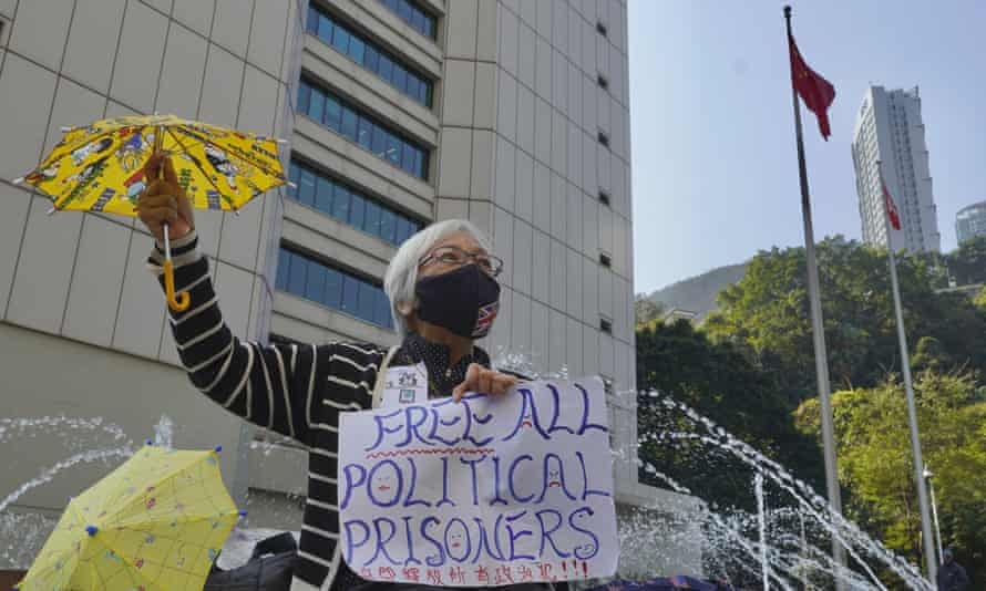 A woman protests against the detention of 'political prisoners' outside the high court in Hong Kong.