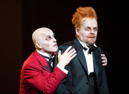 Christopher Purves as Mephistopheles and Peter Hoare as Faust in Terry Gilliam's The Damnation of Faust, for the English National Opera.