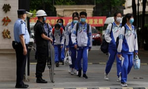 Chinese students wearing face masks amid concerns of coronavirus leave a middle school on 11 May 2020 in Beijing, China.