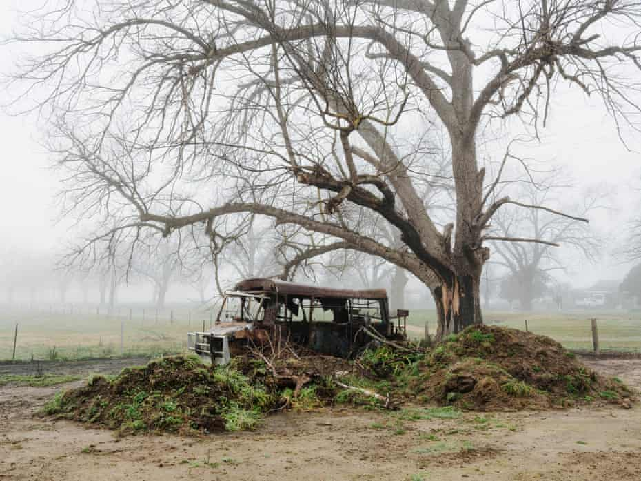 Cleared land and the remnants of a bus is all that remains at Joshua Collings' place, one of many properties that burned when bushfires tore through Cudgewa in northeastern Victoria.