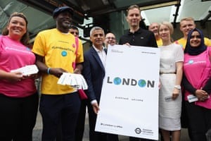 Sadiq Khan, Justine Simons and, centre, artist David Shrigley launch a new series of artwork by UK and international artists, to be featured across the Tube network