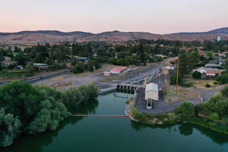 A red-striped circus tent stands next to the headgates of a canal in Klamath Falls.