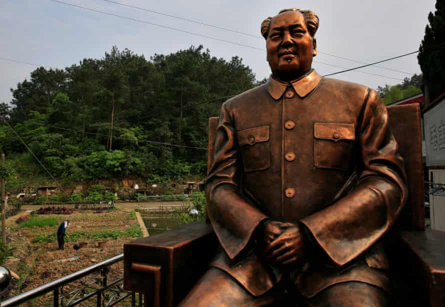 A 4m-high Mao Zedong statue overlooks farmland in Shaoshan, the former Chinese leader's hometown.