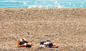 People sunbathing on Chesil beach