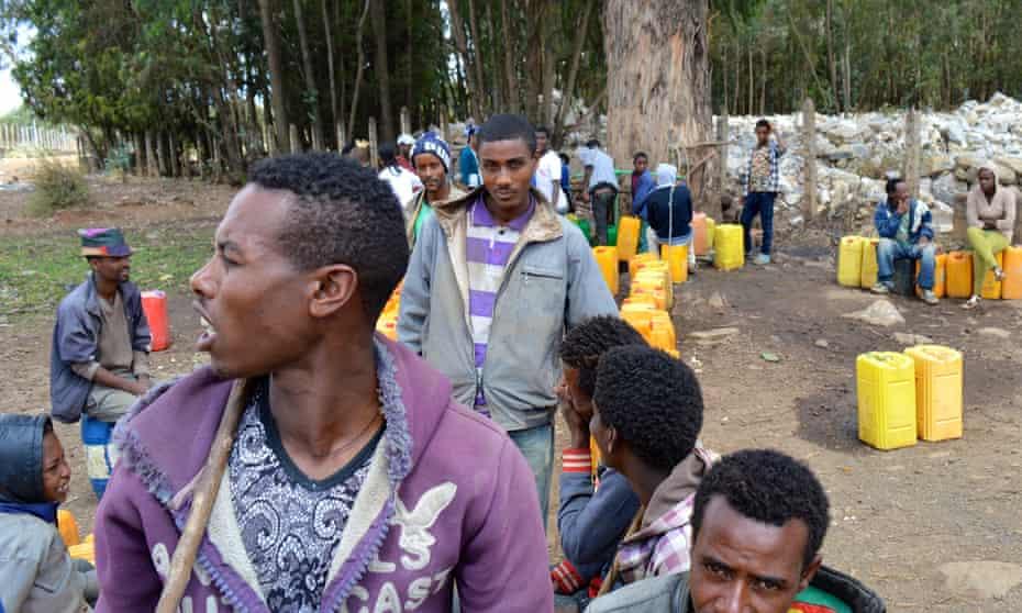 People in Sululta queue for tap water