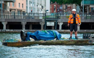 A statue of the slave trader Edward Colston is removed from the harbour where it was dumped by anti-racism protesters in Bristol, UK