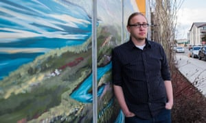 Josh Louwerse, a youth engagement program coordinator, stands outside of Covenant House in downtown Anchorage.