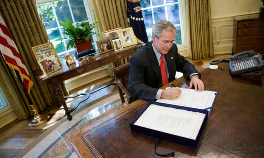 George W Bush in the Oval Office