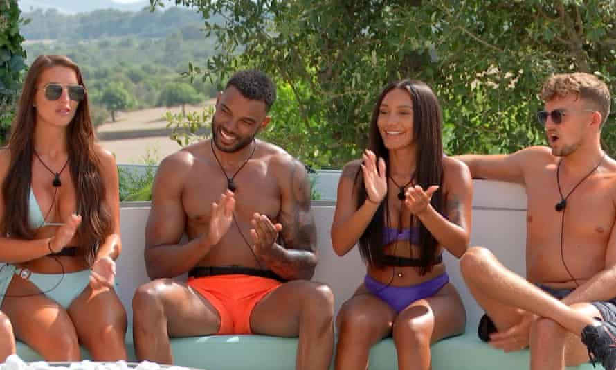 Amy, Tyler, Clarisse and Hugo sitting and clapping in the current season of Love Island.