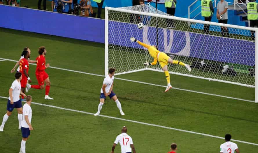 Players from both side watch in awe as Adnan Januzaj fires Belgium's winner past Jordan Pickford.