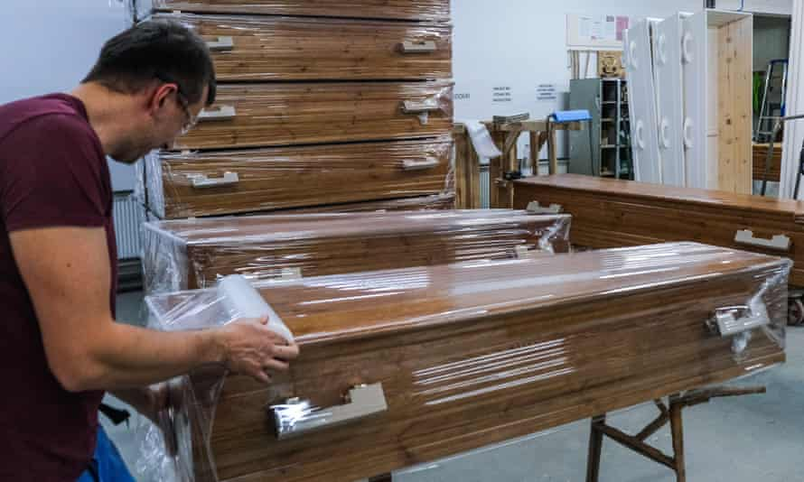 A worker assembles a coffin. Direct cremations accounted for 14% of all funerals in 2020, up from 3% in 2019.