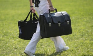 A White House military aide carries a briefcase known as the 'football', containing emergency nuclear weapon codes. Donald Trump has place a new emphasis on 'usable' tactical nuclear weapons.