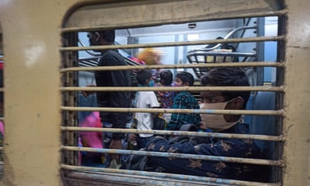 Children aboard a train leave for industrial cities for work.