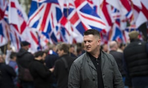 Tommy Robinson, former leader of the English Defence League, and far-right supporters protest in London.