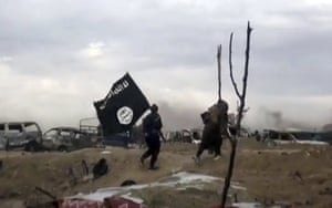 Baghuz, Syria. A frame from a video posted online by Islamic State shows fighters carrying the group's flag in their last pocket of territory in Syria