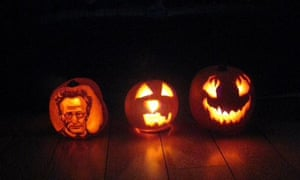 Carved Halloween pumpkins, including one with a portrait of Schrodinger's pumpkin