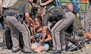 Tribune Law enforcement arrested several people protesting the Dakota Access pipeline on a newly constructed roadway to be used in building the pipeline Thursday, Aug. 11, 2016.