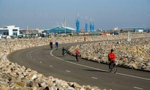 Cyclists crossing Cardiff bay barrage by bike.