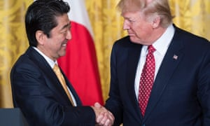 Shinzo Abe and Donald Trump shake hands after a press conference in the White House.