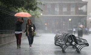 Tourists run as strong winds and heavy rain from Hurricane Nate begin to come ashore in New Orleans.