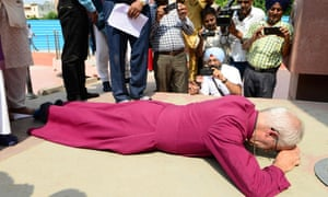 The archbishop of Canterbury, Justin Welby, prostrates himself in tribute to the victims of the Amritsar massacre